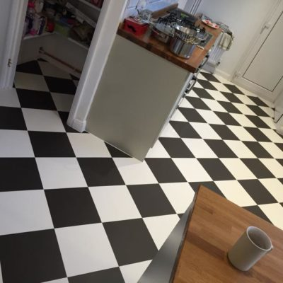 Checked pattern flooring in kitchen