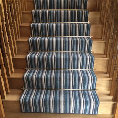 Carpet on wooden stairs